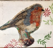 Embroidered Robin with found fabric